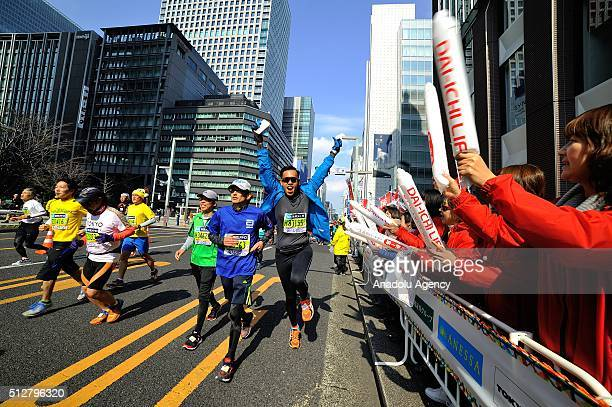 Runners cross Tokyo city as they compete in the Tokyo Marathon on February 28 2016 in Tokyo Japan Thousands people take part in the Tokyo Marathon...