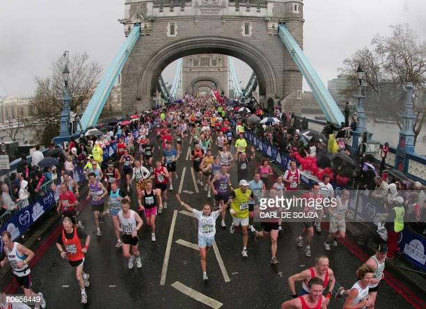 Runners cross Tower Bridge during the 2008 Flora London Marathon on April 13 London. AFP PHOTO/CARL DE SOUZA