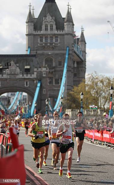 Runners Cross Tower Bridge during the Virgin London Marathon 2012 on April 22 2012 in London England