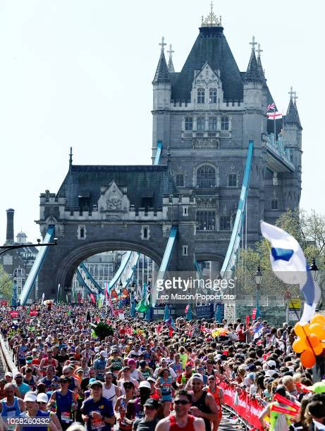 Runners cross Tower Bridge during The Virgin London Marathon on April 22 2018 In London