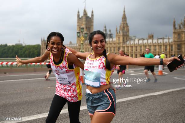 Runners cross Westminster Bridge during the ASICS London 10K on July 25, 2021 in London, England. The race, which has 14,000 registered runners, is...
