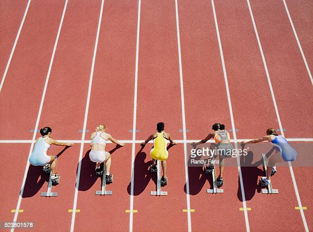 runners crouched at starting line - starting line stock pictures, royalty-free photos & images