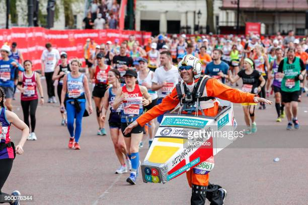 Runners dress in fancy costumes to fundraise money for charities during the Virgin Money London Marathon in London, England on April 22, 2018.