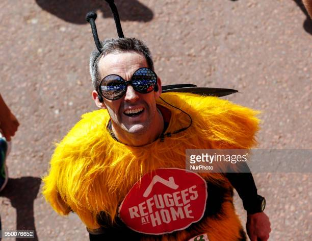 Runners dress in fancy costumes to fundraise money for charities during the Virgin Money London Marathon in London England on April 22 2018