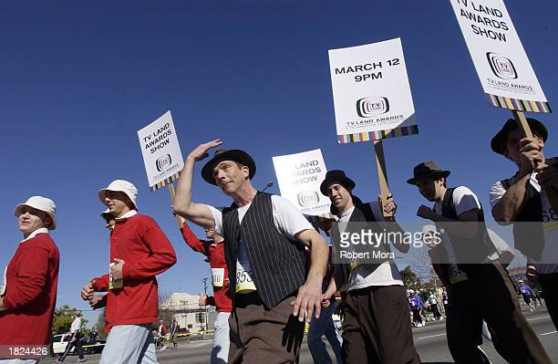Runners dressed as Ed Norton from the show The Honeymooners and Gilligan from Gilligan's Island participate in the 2003 Los Angeles Marathon to...