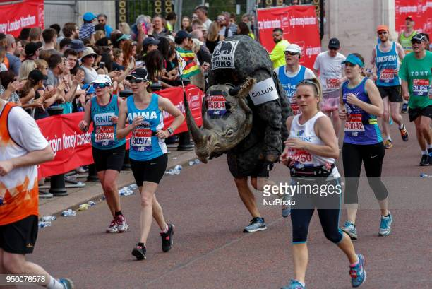 Runners dressed in fancy costumes fundraise money for charities during the Virgin Money London Marathon in London England on April 22 2018