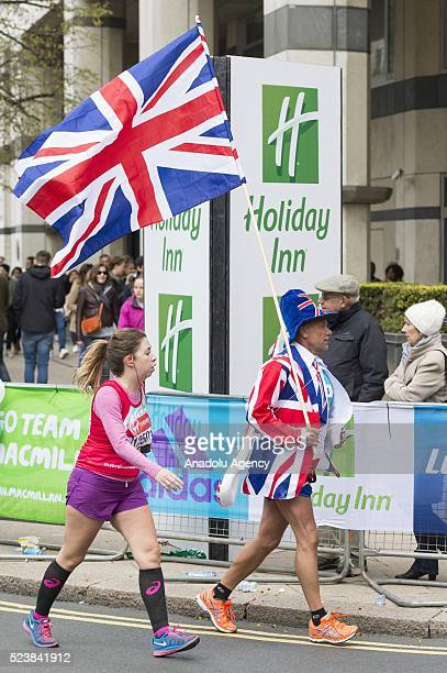 Runners dressed in the Union Jack flag at the 2016 London Marathon in London United Kingdom on April 24 2016