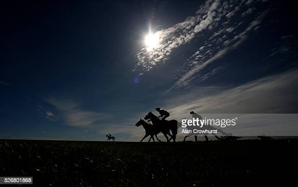 Runners ease down up the hill after finishing at Newmarket racecourse on May 1 2016 in Newmarket England