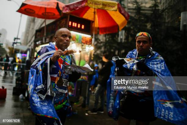 Runners eats a snack after finishing the 2017 TCS New York City Marathon November 5 2017 in New York NYPD department had doubled the number of...