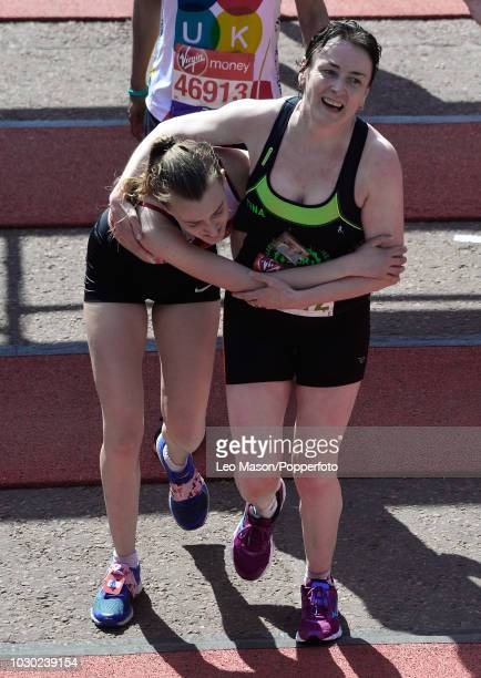 Runners embrace at the finish on The Mall during The Virgin London Marathon on April 22 2018 in London England