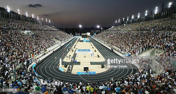Runners enter the stadium and near the finish during the men's marathon on August 29 2004 during the Athens 2004 Summer Olympic Games at Panathinaiko...