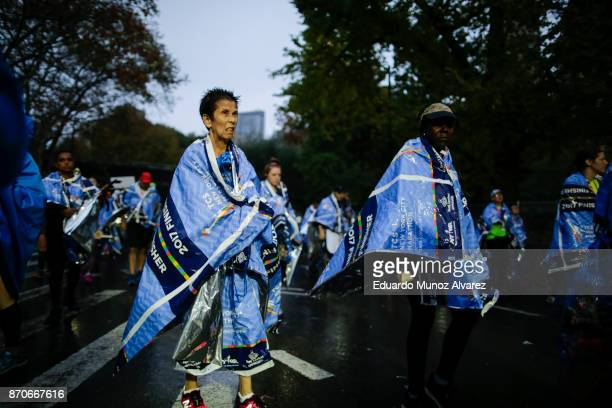 Runners exit the area after finishing the 2017 TCS New York City Marathon November 5 2017 in New York NYPD department had doubled the number of...