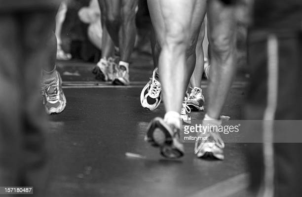 runners feet and legs - road race stock pictures, royalty-free photos & images