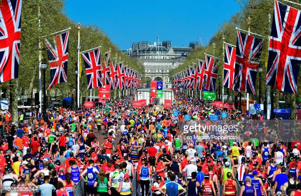 Runners finish on The Mall during the The Virgin London Marathon on April 22 2018 in London England