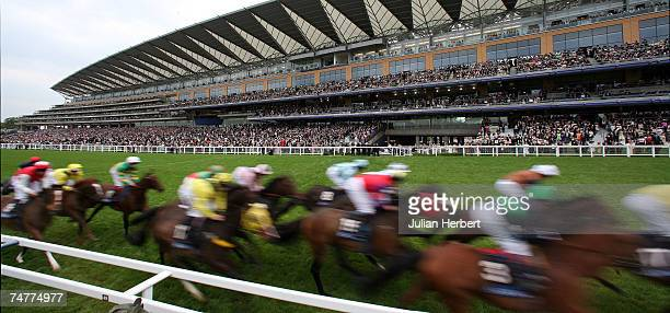 Runners flash past the stands for the first time during The Ascot Stakes Race run at Ascot Racecourse during the First day of The Royal Meeting held...