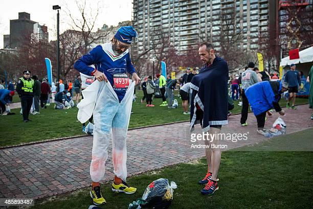 Runners get ready to run the Boston Marathon in the Boston Commons on April 21 2014 in Boston Massachusetts Today marks the 118th Boston Marathon...