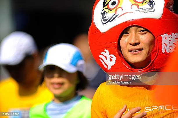 Runners go across Tokyo city as they compete in the Tokyo Marathon on February 28 2016 in Tokyo Japan Thousands people take part in the Tokyo...