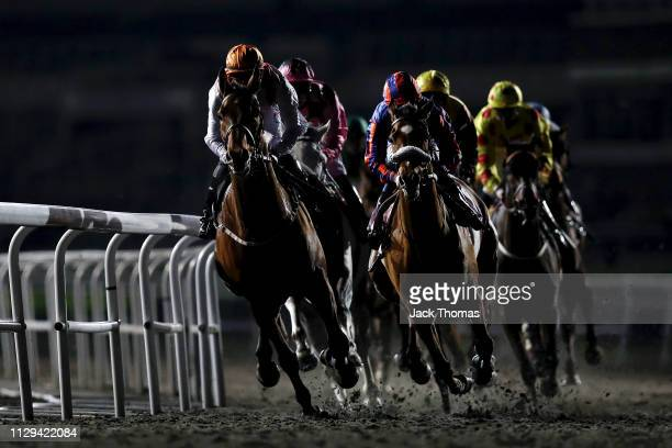 Runners go around the bend during the second race at Kempton Park on February 13 2019 in Sunbury England