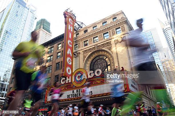 Runners go by the Chicago Theatre during the 2015 Bank of America Chicago Marathon on October 11 2015 in Chicago Illinois