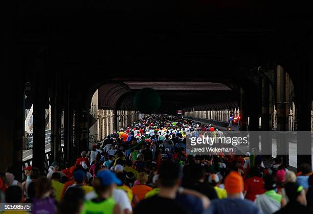 Runners go through the Queensboro Plaza subway overpass as they compete in the 40th ING New York City Marathon on November 1 2009 in the Queens...