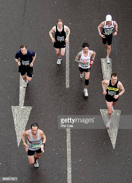 Runners go under Waterloo Bridge during the 2008 Flora London Marathon on April 13 2008 in London England