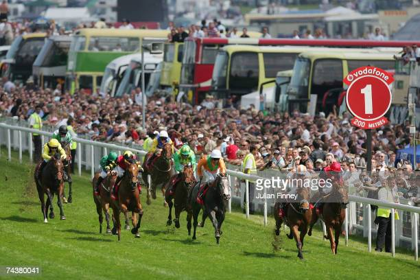 Runners head down the home straight in the second race during The Vodafone Derby Race run at Epsom Racecourse on June 2 2007 in Epsom England