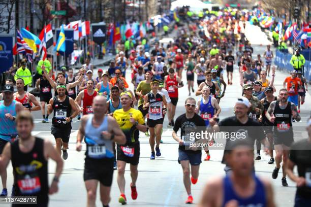 Runners head to the finish line on Boylston Street in Boston during the 123rd Boston Marathon on April 15, 2019.