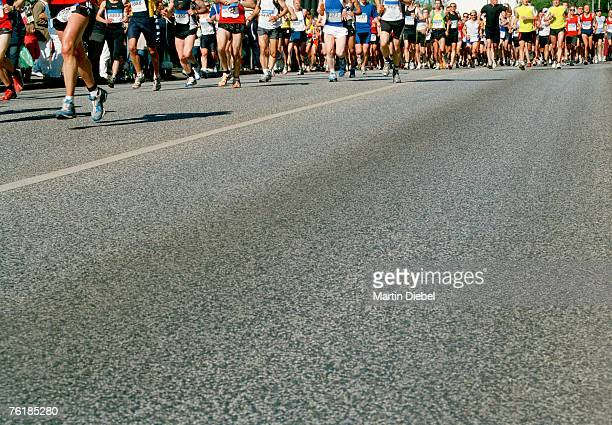 runners in a marathon - marathon stock pictures, royalty-free photos & images
