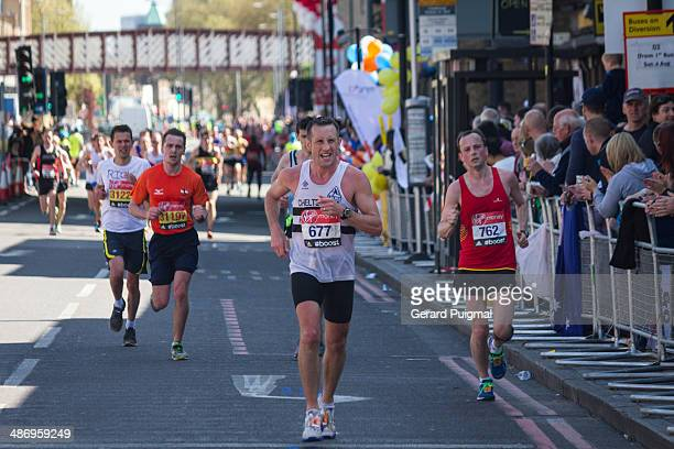 Runners in Commercial Road during the London Marathon 2014