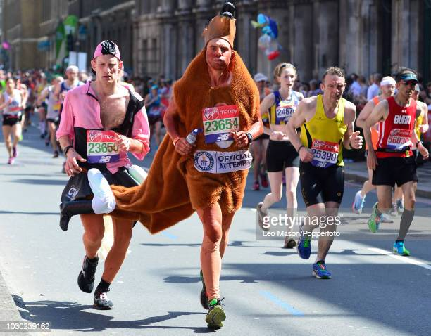 Runners in fancy dress along the course during the Virgin London Marathon on April 22 2018 in London England