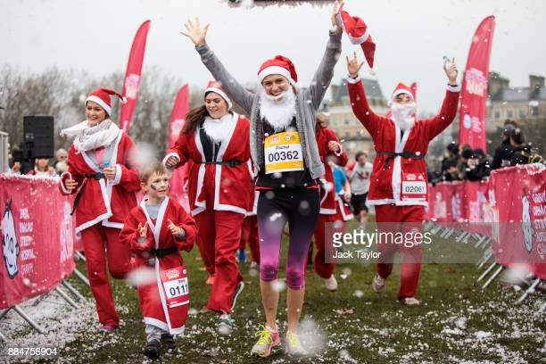 Runners in Father Christmas outfits take part in the annual Santa Dash run on Clapham Common on December 3 2017 in London England Two thousand...
