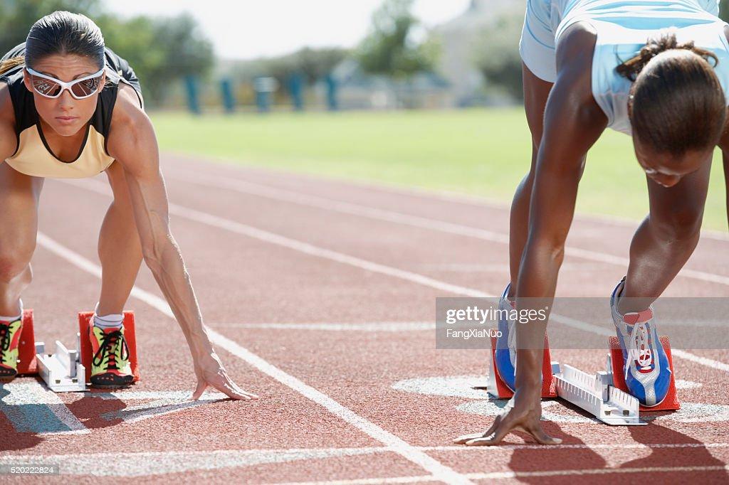 Runners in starting blocks : Stock Photo