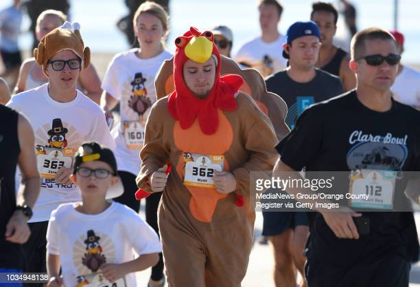 Runners in the 15th annual Long Beach Turkey Trot are encouraged to wear Thanksgiving costumes during the run on Thursday November 23 2017 Justin...