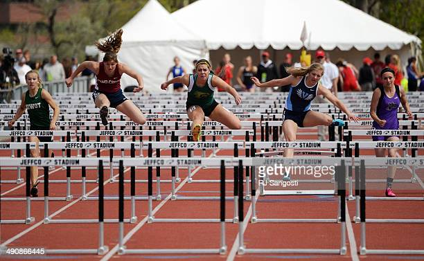 Runners in the 4A qualifying 100m hurdles race to the finish line during the Colorado High School State Track and Field Championships May 15 2014...