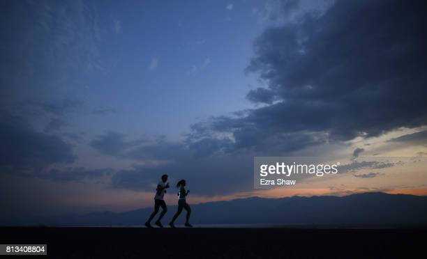 Runners in the 800pm start wave leave the start line at sunset during the STYR Labs Badwater 135 on July 10 2017 in Death Valley California There are...