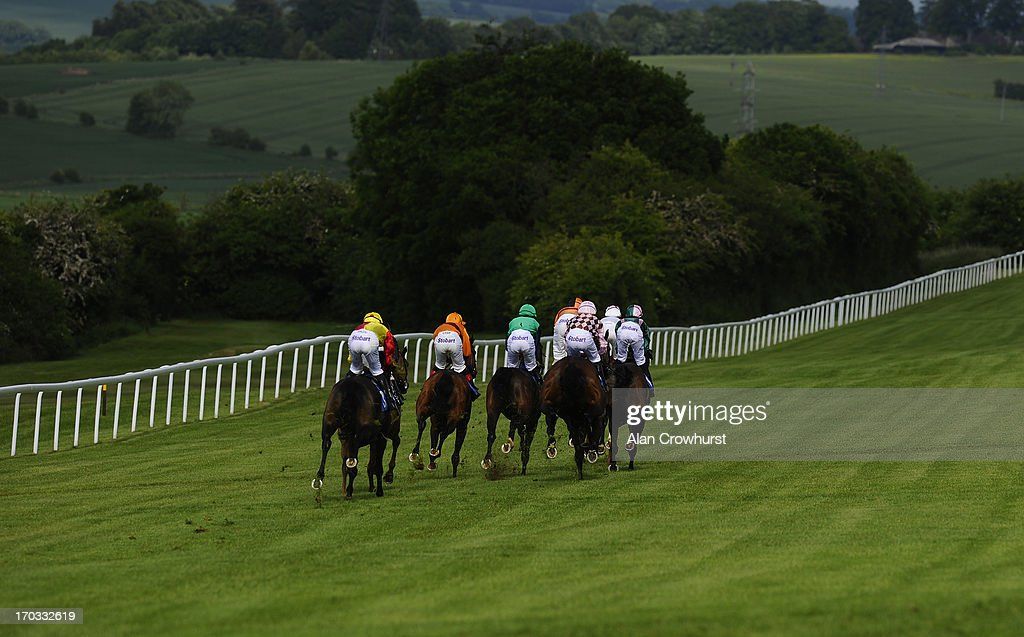 Runners in The Bathwick Tyres Handicap Stakes make their way into the country at Salisbury racecourse on June 11, 2013 in Salisbury, England.
