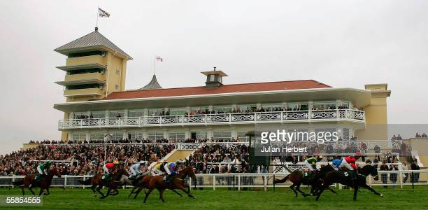 Runners in The Epson Beginners Steeple Chase pass the new grandstand at Towcester Racecourse on October 5 2005 in Towcester England