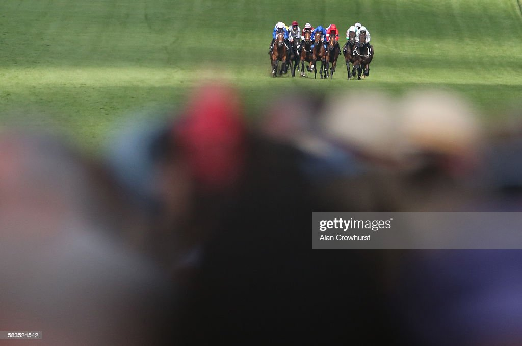 Runners in The Irish Thoroughbred Maeketing EBF Stallions Maiden Stakes race towards the finish at Goodwood on July 26, 2016 in Chichester, England.