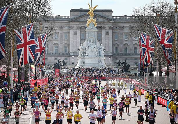 Runners in the London Marathon pass Buckingham Palace as they enter the finishing straight on April 21 2013 in London England Thousands of runners...
