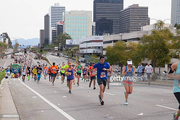runners in the los angeles marathon - westwood neighborhood los angeles stock pictures, royalty-free photos & images