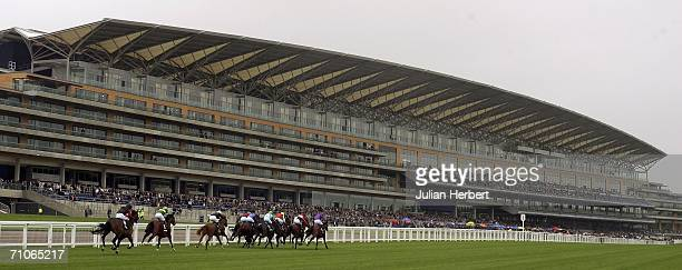 Runners in The McGee Group Conditions Stakes Race pass the new grandstand at Ascot Racecourse on May 27 in Ascot, England. Today was the first time...