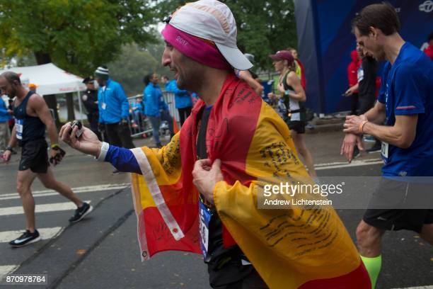 Runners in the New York City marathon finish the race on November 5 2017 in Central Park in New York