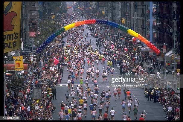 Runners in the New York City Marathon run down 1st Avenue in Manhattan under an arch made of rainbow colored balloons November 2 1986