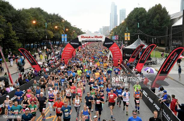 Runners in the Rock n Roll Chicago Half Marathon and 10K race leave the starting line on July 22 2018 in Chicago Illinois