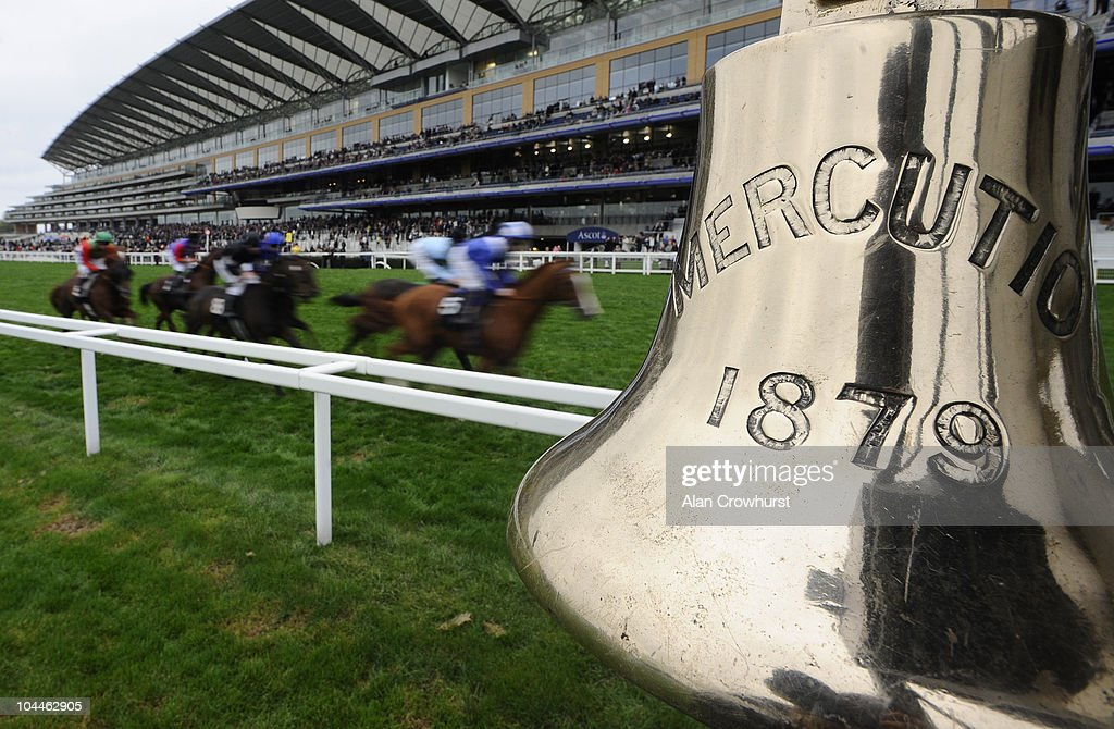 Runners in The SIS Live Fenwolf Stakes pass the Ascot bell that is rung when the runners turn into the home straight at Ascot racecourse on September 26, 2010 in Ascot, England