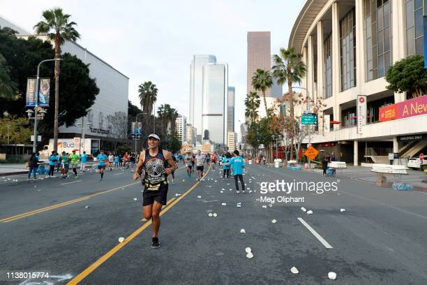 Runners in the Sketchers Performance Los Angeles Marathon pass Grand Park on March 24 2019 in Los Angeles California