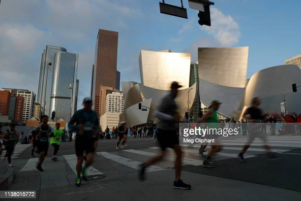 Runners in the Sketchers Performance Los Angeles Marathon pass the Walt Disney Concert Hall on March 24 2019 in Los Angeles California