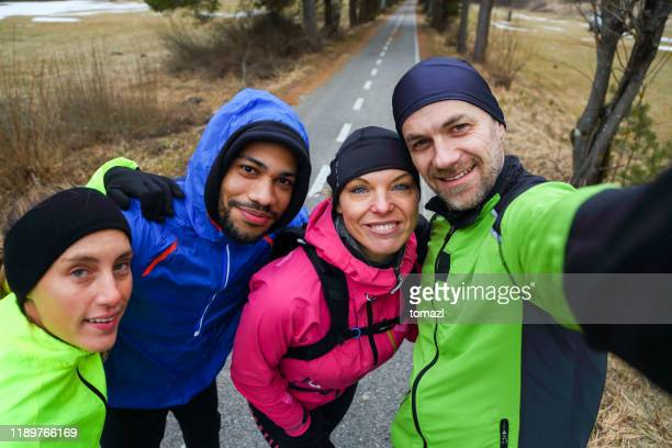 runners in winter selfie - group of people stock pictures, royalty-free photos & images