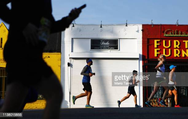 Runners jog up Sunset Boulevard during the 34th annual LA marathon on March 24 2019 in Los Angeles California More than 20000 runners competed in the...