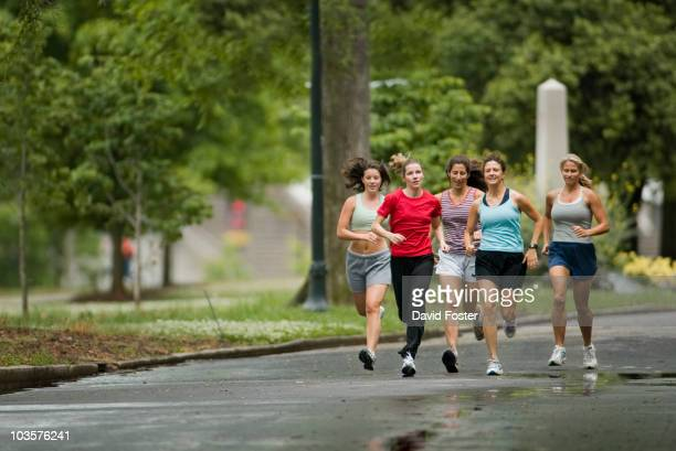 Runners jogging in park